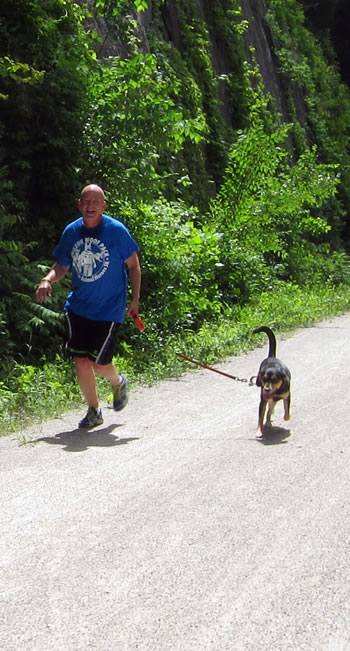 MU CVM Professor Craig Franklin, DVM, PhD, DACLAM, runs along the Katy Trail State Park as part of the Woof Pack, raising funds for Homes for Animal Heroes.