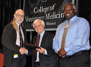 Dennis O'Brien (left) received the Dadd Award from CVM Dean Neil C. Olson (center) and last year's recipient, Fred Williams III.