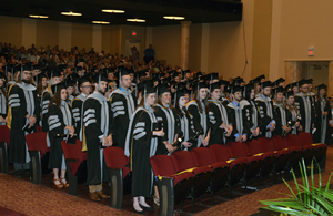 The MU College of Veterinary Medicine Class of 2017 prepares to the take the Veterinarian's Oath.