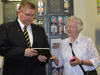 Susan Fales looks at her husband's plaque after a ceremony inducting William Fales into the Veterinary Honor Roll.