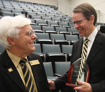 CVM Alumnus of the Year for 2016 Roger Fingland (right) shares a laugh with Dean Neil C. Olson following the presentation of Fingland's award.