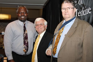 Fred Williams III (left) received the Dadd Award from CVM Dean Neil C. Olson (center) and last year's recipient, William Fales.