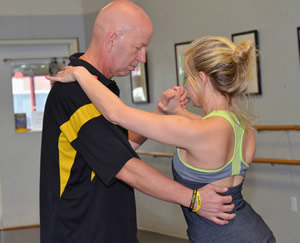 CVM Professor Craig Franklin is first learning the basic steps for each of two dances before his coach, Caitlin Sloan, adds some flair to their performance.
