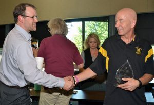Assistant Teaching Professor Kevin Donnelly (left) congratulates Craig Franklin on his Impact Award.