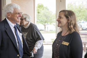 Veterinary Health Center Director David Wilson visits with Melinda Cartwright, wife of the MU chancellor at the anniversary celebration for Clydesdale Hall.