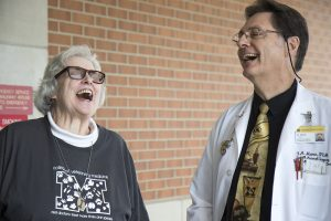 Professor F. A. (Tony) Mann, director of Small Animal Emergency and Critical Care Services, shares a laugh with Barbara Levy, a VHC client and supporter of the college.