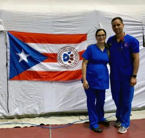 Aida Vientós-Plotts, DVM, and Willie Bidot, DVM, rock the colors of their birthplace, Puerto Rico. The former VHC residents formed a nonprofit to support the island after Hurricane Maria.