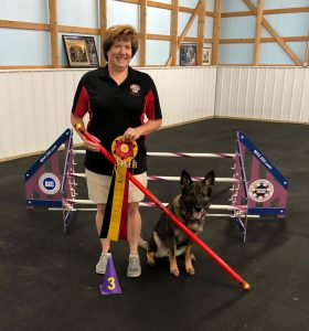 Vicki Miller, MU College of Veterinary Medicine fiscal officer and human resource manager, with her dog Schatzi in June after Schatzi claimed her third Master Agility Champion title on her way to ranking as the top German shepherd dog in the 2019 American Kennel Club Agility Invitational.