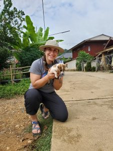 Tess Van Kan with a puppy in Thailand