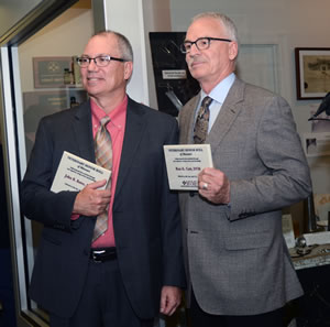 John R. Bates, DVM, and Ron Cott display their Veterinary Honor Roll plaques.