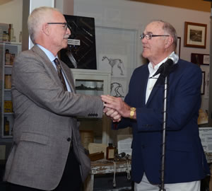 """Robert """"Bud"""" Hertzog, DVM, congratulates Ron Cott on his induction into the Missouri Veterinary Medical Foundation Honor Roll."""