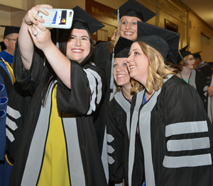 MU CVM students stop for a selfie before the start of graduation ceremonies May 12, 2017.