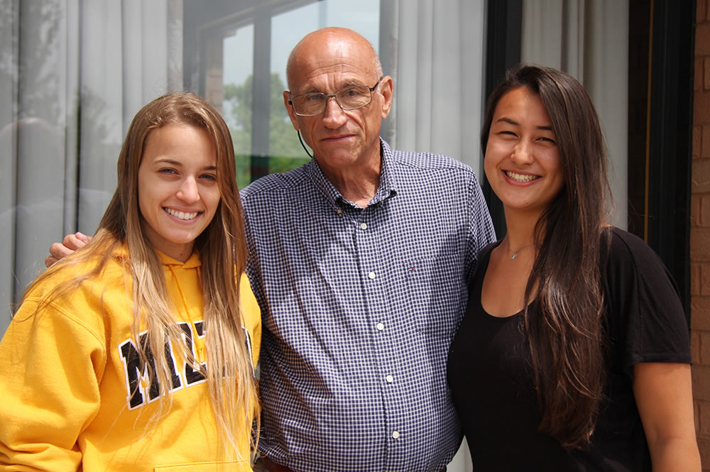Rottinghaus with visiting scholars Larissa Franco (left) and Amanda Chan Cirelli. The Brazilian students recently completed six-month internships in the Rottinghaus lab.
