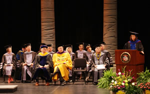 Members of the platform party listen to speaker Michelle Haven, DVM, PhD, during the CVM graduation ceremony.