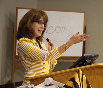 Senior Director of Advancement Janie Harmon welcomes Alumni Weekend attendees to the Friday evening dinner.