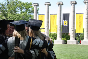 CVM graduates celebrate receiving their doctor of veterinary medicine degrees.