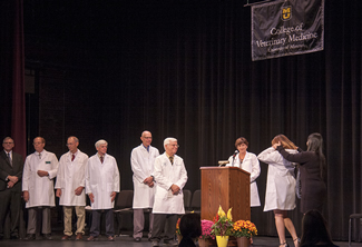 The White Coat Ceremony platform party (from left): Richard Antweiler, executive director, Missouri Veterinary Medical Association, Mel Falk, DVM, president, Missouri Veterinary Medical Association, Daniel Shaw, DVM, PhD, professor, Veterinary Medical Diagnostic Laboratory, David Wilson, DVM, MS, director, Veterinary Health Center, John Dodam, DVM, MS, PhD, chairman, Department of Veterinary Medicine and Surgery, Neil C. Olson, DVM, PhD, dean, College of Veterinary Medicine, and Angela Tennison, DVM, associate dean for Student Affairs. Also participating in the ceremony, but not visible in the image, was Linda Berent, DVM, PhD, associate dean for Academic Affairs.
