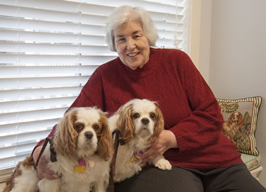 Barbara and Ken Levy's relationship with the University of Missouri College of Veterinary Medicine began when one of their Cavalier King Charles spaniels needed medical care. The Levys have been giving back to the college ever since. Barbara Levy, pictured with her dogs, Nessa and Sophie, came up with the idea of serving dinner to the faculty, staff and students on duty Thanksgiving Day at the Veterinary Health Center. This Thursday marks 20 years of that tradition.