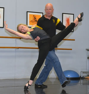 Caitlin Sloan, a member of the Missouri Contemporary Ballet in Columbia, teaches College of Veterinary Medicine Professor Craig Franklin a tango for his upcoming performance in the 10th Annual Dancing with the Missouri Stars.