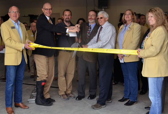 The Columbia Chamber of Commerce Ambassadors helped with the ribbon cutting to celebrate the opening of the new Veterinary Health Center Ambulatory facility. Representing the VHC were Chairman of Veterinary Medicine and Surgery John Dodam (second from left), Facility Supervisor Jason Brandow (third from left), Professor of Food Animal Medicine and Surgery John Middleton (center), and VHC Hospital Director David Wilson.
