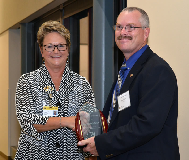 MU CVM Interim Dean Carolyn Henry, DVM, MS, DACVIM, presents the Alumnus of the Year Award to Bruce Whittle.