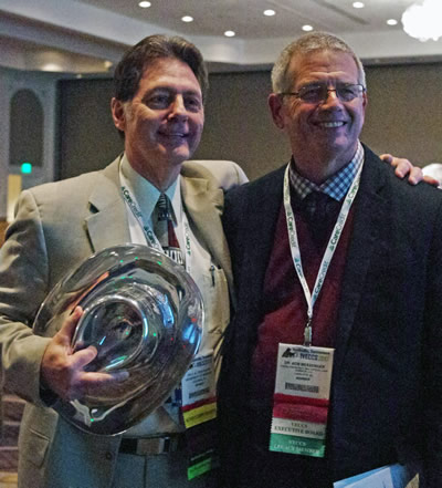 Bob Messenger, DVM, president of the Veterinary Emergency and Critical Care Society, congratulates the CVM's Tony Mann on receiving the Ira M. Zaslow Distinguished Service Award.