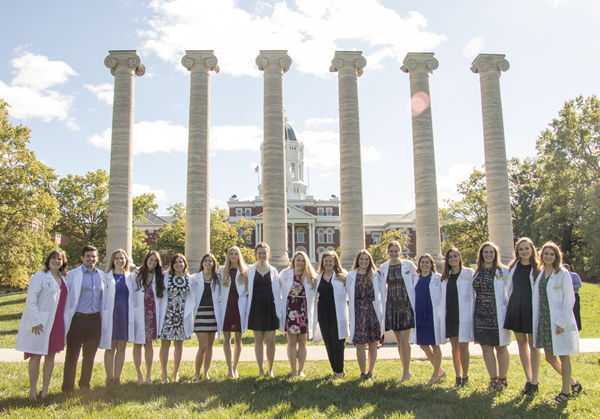 Third-year CVM students gathered for a photo with their friends in front of the MU columns after receiving their white lab coats in a ceremony that celebrates their transition to the clinical portion of their education.