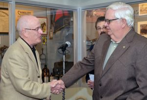 George Buckaloo (left) congratulates Bill Jones after Jones is inducted into the Missouri Veterinary Medical Foundation Honor Roll. MVMF Chairman Phil Brown, DVM, served as the emcee for the ceremony.