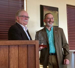Bryan Slinker, Dean at Washington State University's College of Veterinary Medicine, presents John Middleton with the college's Distinguished Veterinary Alumni Award.