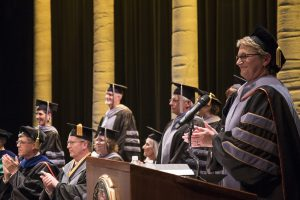 Carolyn Henry celebrates her 100th day as CVM dean by serving as the emcee for graduation. She thanks the graduates for the contributions they made to the college during their education.