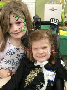 Catherine and older sister Molly sporting festival face paint.