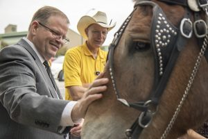 MU Chancellor Alexander Cartwright greets the CVM Mule team during the Clydesdale Hall 25th anniversary celebration.