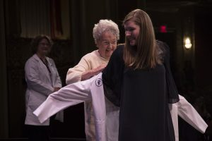 Sarah Rutherford asked her grandmother, Jerry Brand, to present her white coat