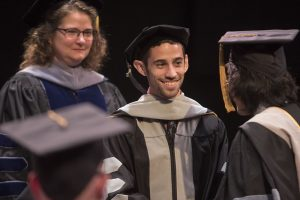Associate Dean for Academic Affairs Linda Berent was assisted in hooding Jonathan Tresner by Clinical Instructor Leon Tu.