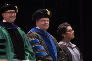 The CVM graduation platform party included (from left) MU Vice Chancellor for Agriculture and Dean of the College of Agriculture, Food and Natural Resources Christopher Daubert, Chancellor Alexander Cartwright and Executive Director of the Veterinary Leadership Institute Betsy Charles.