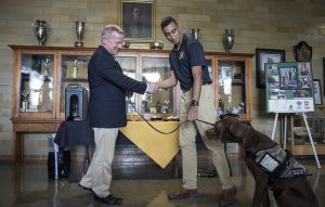 Mizzou ROTC Cadet Ali Abdulaziz, who was Max's primary handler, turned over the dog he has been training since September 2018, to retired Lt. Col. John Hopson.