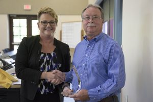 CVM Dean Carolyn J. Henry presents the 2019 Dean's Impact Award for an individual from outside the college to Bruce Baker, cofounder and hospital manager of Pet Center, Ltd., for his sustained and significant positive impact on CVM programs.