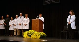 Associate Dean for Student Affairs Angela Tennison, who served as the White Coat master of ceremonies, introduced the platform party (from left): Carol Ryan, president of the Missouri Veterinary Medical Association, Richard Antweiler, executive director of the Missouri Veterinary Medical Association, Shuping Zhang, director of the Veterinary Medical Diagnostic Laboratory, David Wilson, director of the Veterinary Health Center, John Dodam, chairman of the Department of Veterinary Medicine and Surgery, CVM Dean Carolyn Henry, Tennison, and Linda Berent, associate dean for Academic Affairs.