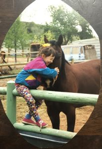 Silvey has enjoyed spending time around animals since childhood. She is shown here at age 4 or 5 with a horse belonging to her uncle's neighbor.
