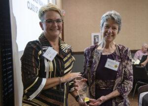 CVM Dean Carolyn Henry presents Associate Adjunct Professor Colette Wagner-Mann with an Alumnus of the Year plaque.