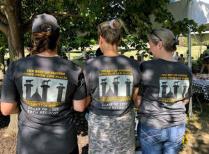 Graduates from the CVM Class of 1991 wear matching class T-shirts during the Alumni Weekend Tailgate.